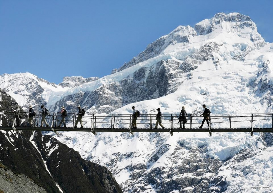 Hikers explore an ice-capped mountain near Christchurch.